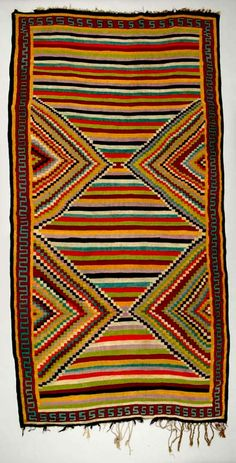 folksielady:  Africa | Floor rug from Sidi Bou Zid, Tunisia | ca. 1930 - 50 | Wool; plain woven, interlocking tapestry | Tunisian kilims were woven as floor coverings and placed either by themselves or as protective covers on top of knotted-pile carpets. Kilims from Sidi Bou Zid in central Tunisia are famous for their brightly coloured, bold geometric patterns arranged in panels and executed in the interlocking-tapestry weave.