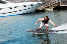 radinn electric powered wakeboard commanded by a wireless handcontrol