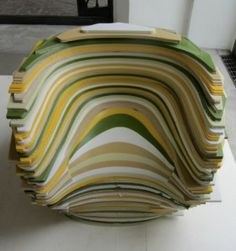 """Corian's extensive exhibit was all about color combinations. Designer Rabih Hage explained his motivation as """"treating the off-cuts and discarded planks …as noble material re-used in luxurious furniture pieces."""" This green/yellow/taupe/white combination was spotted elsewhere at the Milan furniture fair."""