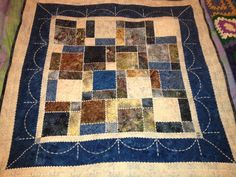 Snowflake batik charm square lap quilt. I am especially pleased with the machine quilting on this one. January 2015