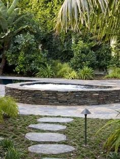 Tranquil backyard setting for nice hot tub. Learn what you could do in your own back yard. Visit www.custombuiltspas.com
