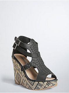 """<p>Walk this way, these shoes were made for a runway strut. The sky-high style lifts off to higher ground with a multi geo stitch wedge. The cage front is embellished with a quilted black faux leather strap that lends edge to the boho babe style.</p>  <ul> <li>5"""" wedge with 0.75"""" platform</li> <li>Man-made materials</li> <li>Imported</li> </ul>"""
