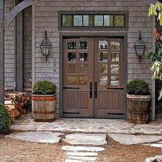 Iron strap hinges and tall escutcheons backing the doorknobs on a set of double doors imparts an old-fashioned, barn-like look to this front stoop: http://www.bhg.com/home-improvement/door/exterior/farmhouse-front-door/?socsrc=bhgpin043014hardcorehardware