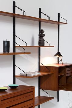 Teak Wall Unit Poul Cadovius with desk Royal System | http://www.furniture-love.com/browse.php | From selection of important 20th century modern furniture.