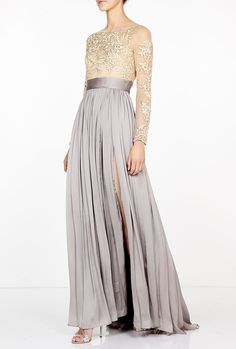 Leigh Split Skirt Maxi Dress by Catherine Deane. The epitome of Hollywood glamour this stunning Catherine Deane evening dress incorporates a flattering design with exquisite detailing to ensure you radiate elegance. Simply pair this striking dress with a towering heel and sparkling accessories for polished red carpet style.