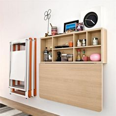 """spacebox-space-saving-wall-mount-table-03. Down..... would it make sense to deepen the cupboard by framing it out between the studs? You could get maybe 6"""" or so of storage or display space."""