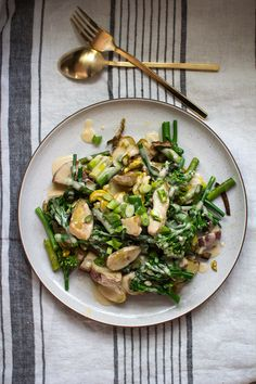 all the spring vegetables covered in a creamy lemon goat cheese sauce