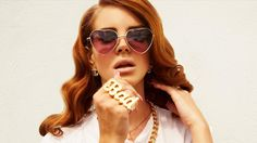 """I RLY can't stand her """"music,"""" but I'm 100 percent on board with what her style and image people are busting out: Frida Kahlo flower crowns? Long, ladies-who-lunch nails and Chanel studs paired with all that Run DMC gold jewelry? Those Lolly glasses and her 1940s waves? YES PLZ."""
