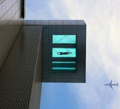 A sky-high swimming pool with a glass bottom.  Too much!!!