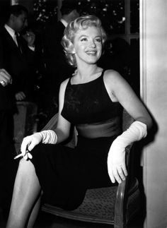 Marilyn and Laurence Olivier at a press conference at the Savoy Hotel, London, July 1956.