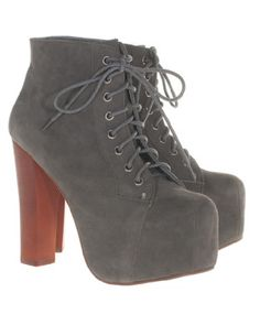 The hype never stops! Jeffrey Campbell creates avantgarde shoes to fall in love with like bloggers and fashionistas like actress Ashley Benson already do... The grey lace-up suede leather booties with
