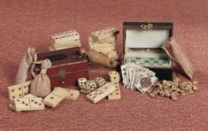 """Theriault's Antique Doll Auctions - French Miniature 19th Century Toys - Included are two miniature """"Loto"""" games in original boxes with gilt lettered name on lid, containing tiny wooden number pegs and die; a set of bone dominoes; wooden whistle; and a set of tiny playing cards. French, circa 1875."""