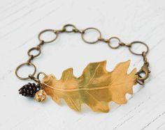 Golden LEAF BRACELET Oak Leaf Pine Cone Nature Forest Woodland Wedding by redtruckdesigns on Etsy https://www.etsy.com/listing/104743418/golden-leaf-bracelet-oak-leaf-pine-cone