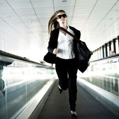 woman in suit running
