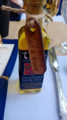 Olive Oil wedding favors with wooden tag.  Tag from Pick Your Plum, Olive Oil from Tiber Canyon Ranch