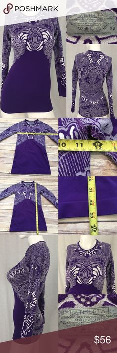 🍭XS Athleta Purple Scroll Print Fitted Tunic Top Measurements are in photos. Normal wash wear, no flaws. E2  I do not comment to my buyers after purchases, do to their privacy. If you would like any reassurance after your purchase that I did receive your order, please feel free to comment on the listing and I will promptly respond. I ship everyday and I always package safely. Thanks! Athleta Tops Tees - Long Sleeve