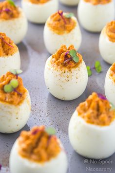 Red Goddess Deviled Eggs - These are naturally colored and a healthy, sweet n' spicy twist on green goddess deviled eggs.  With a super-smooth, creamy filling of roasted red peppers, jalapeno and Greek yogurt, these deviled eggs are perfect for your next party, potluck or Easter celebration!
