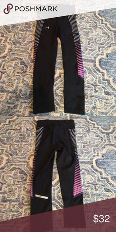 Under armor cropped legging size XS Black Capri leggings with purple side details. XS (runs small) with heat gear and compression fit Under Armour Pants Leggings