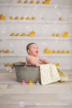 Bathtime baby photography with rubber ducks and bubbles! By Cheryl McCullough