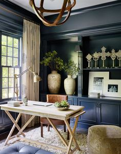 Dark walls but lots of light inside this stunning home office.  Natural woods mixed with the dark paint make it feel so sophisticated  Design by | Andrea Goldman Design