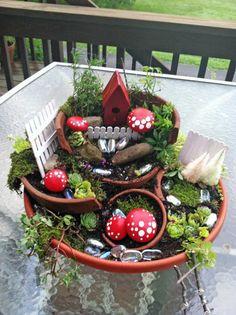 I am so in love with these fairy gardens! Fairy garden magic | Flea Market Gardening