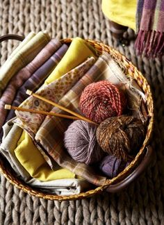 Knitting yarn and sewing fabrics to make warm blankets and quilts to be ready for autumn