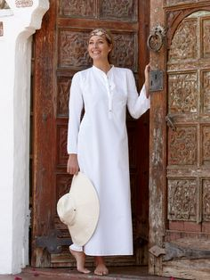 """This sophisticated floor-length kaftan is not—repeat, not—the tent-like garment of the past. Instead, it's a figure-flattering cover-up that is fun to wear. It has a crisp mandarin collar, a long button front placket, gently flared cuffs with vents, underarm mesh and generous 21"""" side slits that deliver equal amounts of coolness and—how shall we say?—leg appeal. It's casual enough to wear by the pool or elegant enough to wear with heels to a party."""