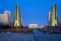 Kazakhstan, Astana, Ak Orda Presidential Palace and twin golden conical business…