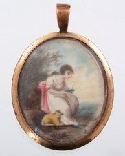 Sentimental scene of a woman and lamb, hand-painted miniature on ivory with gold-filled mounting.  Hair is in the back.  Circa 1800.