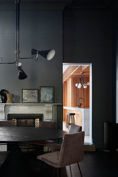 This project by Andrew Simpson Architects combines a very dark and moody interior with high end materials and design items and a beautiful custom wood panelling in the kitchen. The part of the home that is darker is also the … Continue reading → Interior Wood Paneling, Dark Interiors, Upholstered Chairs, Living Area, Interior Inspiration, House Design, Furniture, Beautiful, Decorating Websites