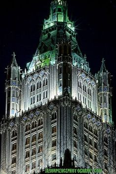 The top of Woolworth Tower, New York City, New York.  The Woolworth Building, designed by architect Cass Gilbert and completed in 1913, is one of the oldest skyscrapers in the United States.