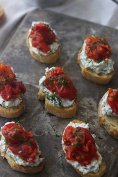 A delicious burst cherry tomato and herbed ricotta crostini recipe that will wow your guests. | Ideahacks.com