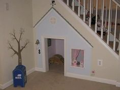 playhouse under the stairs nook - very clever!