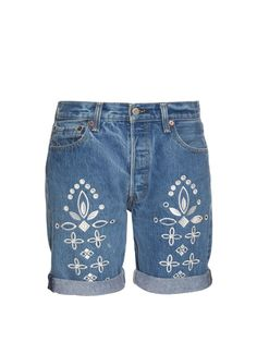 Bliss and Mischief's Shadow Flower shorts are crafted from vintage jeans, and decorated with white embroidery.