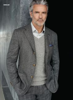 George: this type of sweater, but brown. Black, grey, or different-shade brown slacks. Off-white button down underneath.
