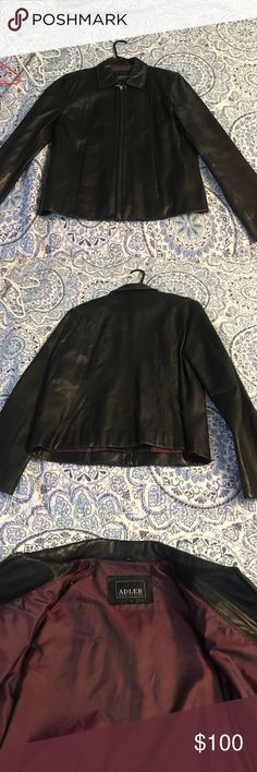 Black leather zip up coat. Super soft lambskin This is a beautiful and buttery soft leather jacket. Zip up style with flat front pockets and inside pockets. Maroon silk lining. Well cared for and stored. New Zealand lamb skin! Make me an offer. I wear dress size 4-8 and even though this is a large, it fits well with room to wear over sweaters and such! adler Jackets & Coats