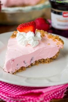 This No-Bake Strawberry Yogurt Pie using Müller® Ice Cream Inspired Yogurt is so creamy and jam packed with strawberry flavor!