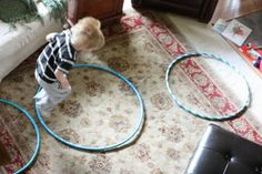 Hula Hoops - great gross motor toy.  Lay several down and have the kids jump from hoop to hoop.  Or play musical hula hoops - the kids really start giggling when it comes to the end and we are stuffing them all into one hoop!