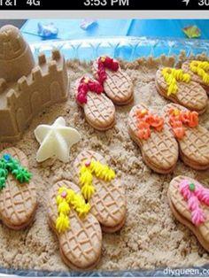 Beach snacks! Flipflop cookies on brown sugar sand with a brown sugar sand castle.  So cute!