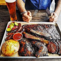 Man vs Food. Ice cold beverages stacks of perfectly smoked mouthwatering brisket and rack upon rack of finger-licking dry-rubbed beef and pork ribs. Basically Heaven. #myfoodeatsyourfood  . Courtesy: @Regrann via Fireworks Smokehouse @fireworkssmokehouse  #july4th #4thofjuly #usa #america #fireworks #grill #grilling #bbq #barbecue #churrasco #ribs #brisket #steak #beef #carne #beer #pork #chicken #meat #meatlover #carnivore #paleo #glutenfree #instagood #foodstagram #foodpics #foodporn…