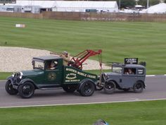 1929 Ford Model A tow truck and 1930 Austin 7 chimney sweep van