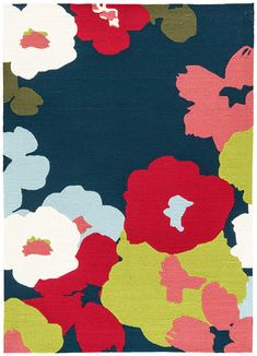 Garden party: In fresh shades of Medieval Blue and Ribbon Red, Wallflower is a stand-out floral motif with large-scale graphic punch.  Rendered in 100 percent polypropylene, this indoor/outdoor design belongs anywhere but on the sidelines!