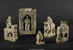 Chess pieces: Rider in carriage drawn by four horses, king in his castle, soldier with shield, warrior on horse, two people on an elephant. South Italy (12th)