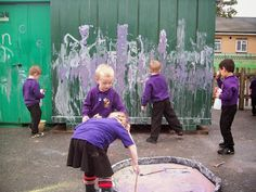(Photo of the week Foundation Stage Two blog) Making chalk paint in the tuff spot, drawing and writing sounds. Squirting the sounds with the water sprayers.