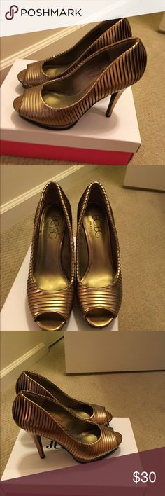 Miss Midas touch! Like and open toe gold bar on you foot, a shoe fit for a queen! BCBG Shoes Heels