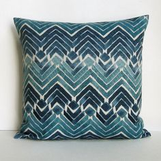 One gorgeous, geometric pillow cover in shades of muted teal blues, turquoise, navy and ivory! This beautiful fabric has a tribal chevron pattern, and will be perfect for accenting any decor! This listing is for one (1) throw pillow cover. ***Insert not included***  • Dimensions: 16 H x 16 W OR 18 H x 18 W OR 20 H x 20 W OR 22 H x 22 W OR 12 H x 16 W OR 12 H x 18 W OR 12 H x 20 W OR 14 H x 22 W • Color: Muted Tones of Turquoise, Teal, Azure, Blue, Indigo, Navy, Pale Ivory/Natural • Mate...