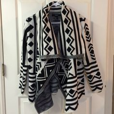 Aztec sweater Black and off white Aztec printed draping open front cardigan. Long sleeves. NWOT. Size M. Very warm and comfy - super cute with jeans or leggings! Please ask any questions prior to purchasing. Thank you! Sweaters