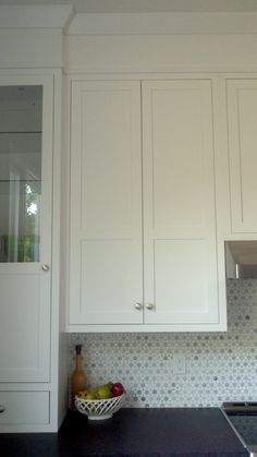 Crown molding pairs well with shaker style cabinetry for Kitchen cabinets for 7 foot ceilings