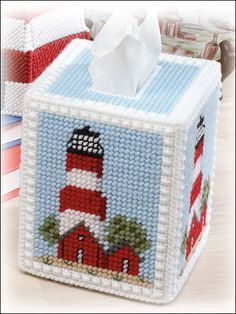 Stitch this lighthouse tissue topper to add to your nautical decor. Skill Level: Intermediate