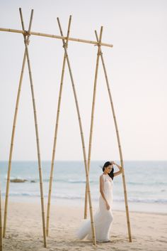 Handcrafted bamboo alter: http://www.stylemepretty.com/destination-weddings/2016/08/25/dreamy-beach-wedding-style-session-at-celebrity-destination/ Photography: Darinimages - http://www.darinimages.com/